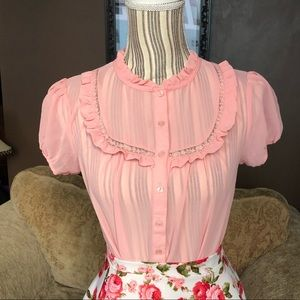 Pink sheer button front ruffle blouse.